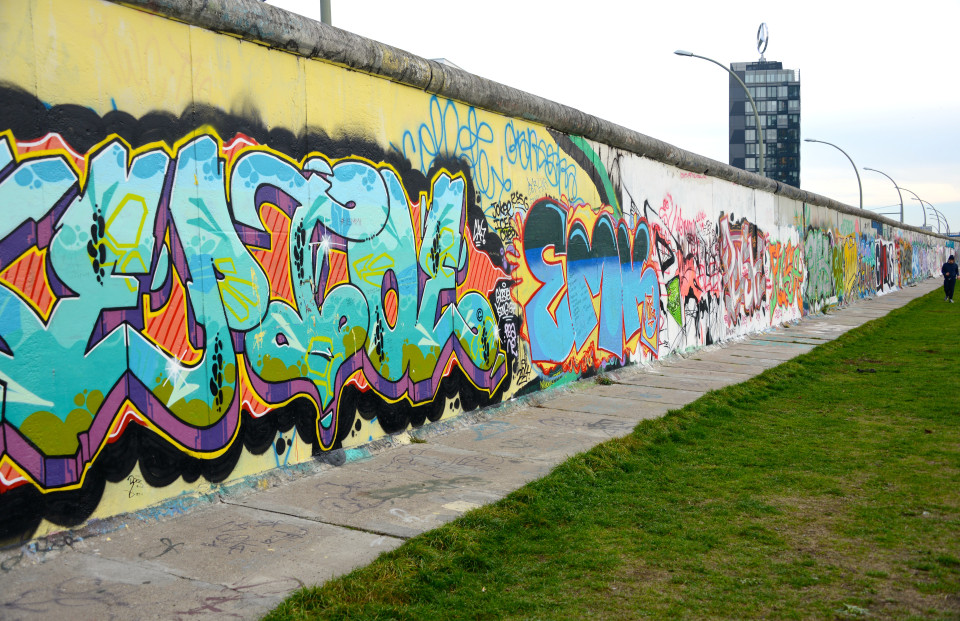 New graffiti on the backside of the Berlin Wall.
