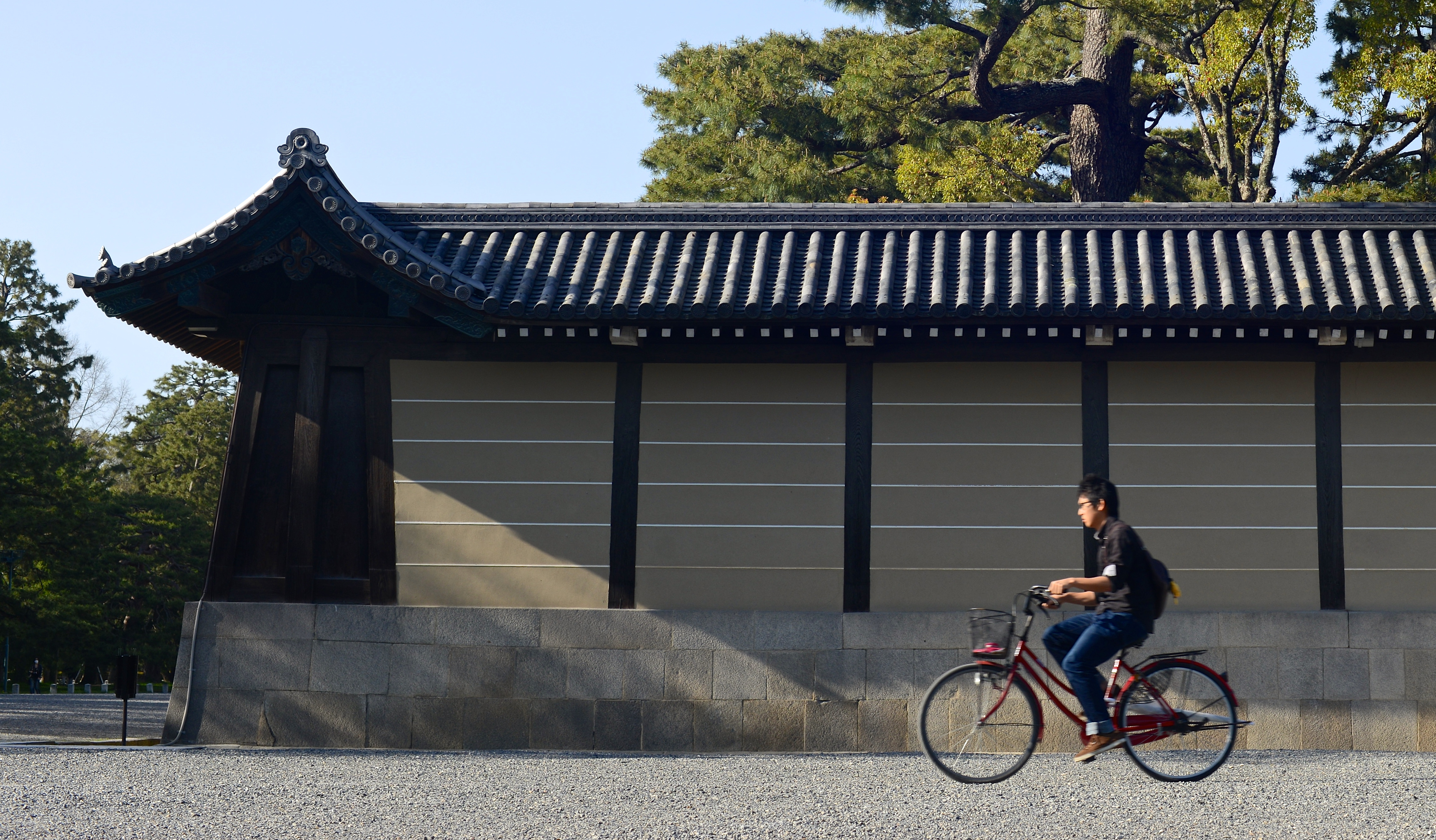 man on bicycle at kyoto imperial palace